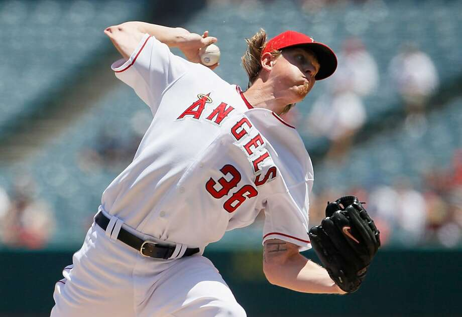 ANAHEIM, CA - JULY 21:  Jered Weaver #36 of the Los Angeles Angels of Anaheim pitches against the Texas Rangers in the second inning at Angel Stadium of Anaheim on July 21, 2011 in Anaheim, California. Photo: Jeff Gross, Getty Images
