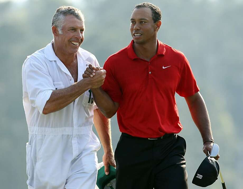 (FILE PHOTO) It has been announced on July 20, 2011 that Tiger Woods has parted company with his caddie of 12 years, Steve Williams.  AUGUSTA, GA - APRIL 10:  Tiger Woods walks off the 18th green with his caddie Steve Williams during the final round of the 2011 Masters Tournament at Augusta National Golf Club on April 10, 2011 in Augusta, Georgia. Photo: Andrew Redington, Getty Images