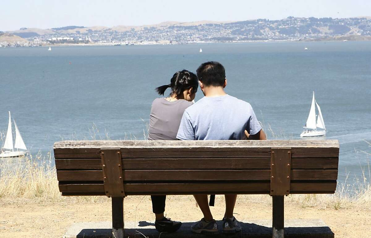 A couple enjoys the day on Angel Island. Angel Island has a variety of hiking and biking trails, historic sites, unsurpassed views, beaches and picnic spots.