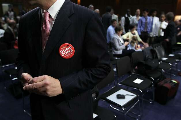 "WASHINGTON - JULY 20:  A man wears a ""DUMP DOMA"" button during a hearing before the Senate Judiciary Committee July 20, 2011 on Capitol Hill in Washington, DC. The hearing was to assess the impact of the Defense of Marriage Act on American families. Photo: Alex Wong, Getty Images"