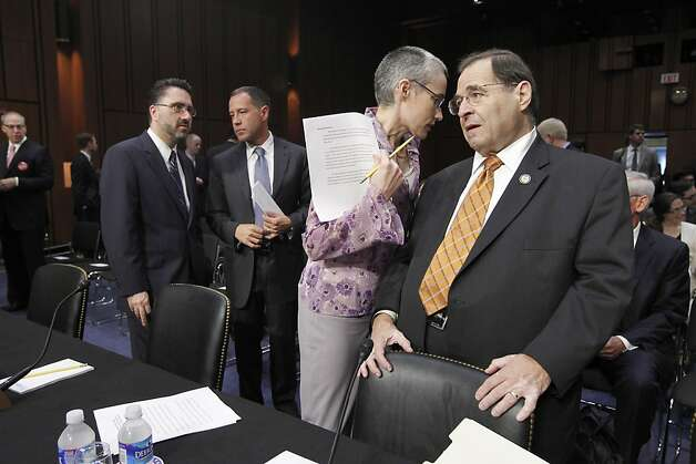 Rep. Jerrold Nadler, D-N.Y., right, is assisted by Heather Sawyer, minority counsel with the House Judiciary Committee, just before the start of a Senate Judiciary Committee hearing to discuss the repeal of the Defense of Marriage Act, on Capitol Hill inWashington, Wednesday, July 20, 2011. Photo: J. Scott Applewhite, AP