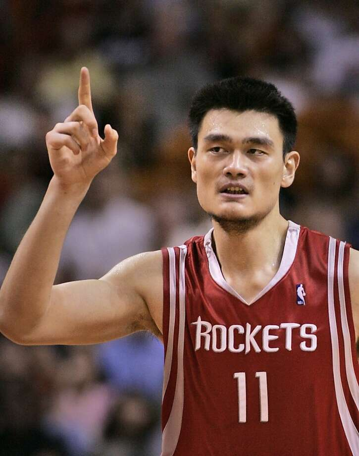 FILE - In this Nov. 12, 2006, file photo, Houston Rockets center Yao Ming, of China, celebrates a basket during the fourth quarter of an NBA basketball game against the Miami Heat in Miami.  Yao has made it official, telling a packed news conference in his hometown Wednesday, July 20, 2011 that a series of injuries have forced him to retire from basketball. Photo: Wilfredo Lee, AP