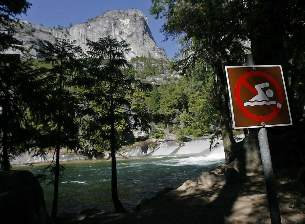A sign prohibits swimming at the Emerald Pool above Vernal Fall on Wednesday, July 20, 2011 in Yosemite National Park in California. Three visitors reportedly died after getting swept over the waterfall on Tuesday. (Eric Paul Zamora/Fresno Bee/MCT)
