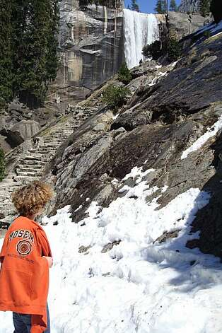 Dominic Tognolini stops at the rock staircase on the Mist Trail this week before making the final tromp up to the foot of 317-foot Vernal Fall. Photo by Paul Evans. April 2010. Photo: Paul Evans