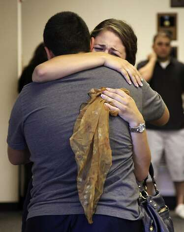 A woman weeps as she is embraced during a vigil held for 3 missing hikers Wednesday, July 20, 2011, at the Holy Apostolic Catholic Assyrian Church of the East in Ceres, Calif. Three people are presumed dead after being swept over a raging waterfall in Yosemite National Park on Tuesday. The three were believed to be in Yosemite as part of a Modesto-based youth church outing. Photo: Ben Margot, AP