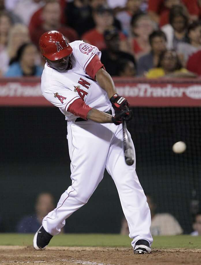 Los Angeles Angels' Howard Kendrick hits a two-RBI single to take the lead against the Texas Rangers in the sixth inning of a baseball game in Anaheim, Calif., Wednesday, July 20, 2011. Photo: Jae C. Hong, AP