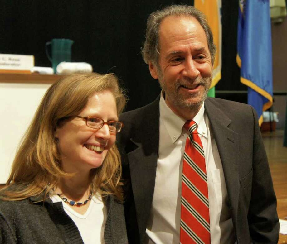 The Representative Town Meeting's moderator, Hadley Rose, and deputy moderator, Eileen Flug, stand in the Town Hall auditorium on Tuesday, Dec. 6, 2011 after being unanimously re-elected to new terms for their respective positions. Photo: Paul Schott / Westport News