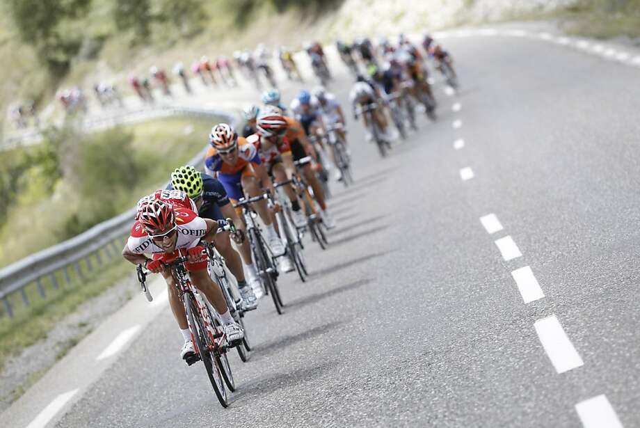 The pack speeds downhill during the 17th stage of the Tour de France cycling race over 179 kilometers (111.2 miles) starting in Gap, Alps region, France, and finishing in Pinerolo, Italy, Wednesday July 20, 2011. Photo: Laurent Cipriani, AP