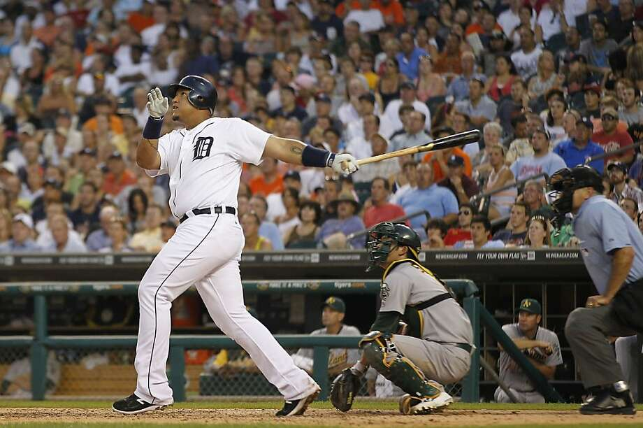 DETROIT - JULY 19: Miguel Cabrera #24 of the Detroit Tigers hits a two run home run in the fifth inning scoring Brennan Boesch #26 during the game against the Oakland Athletics at Comerica Park on July 19, 2011 in Detroit, Michigan. Photo: Leon Halip, Getty Images