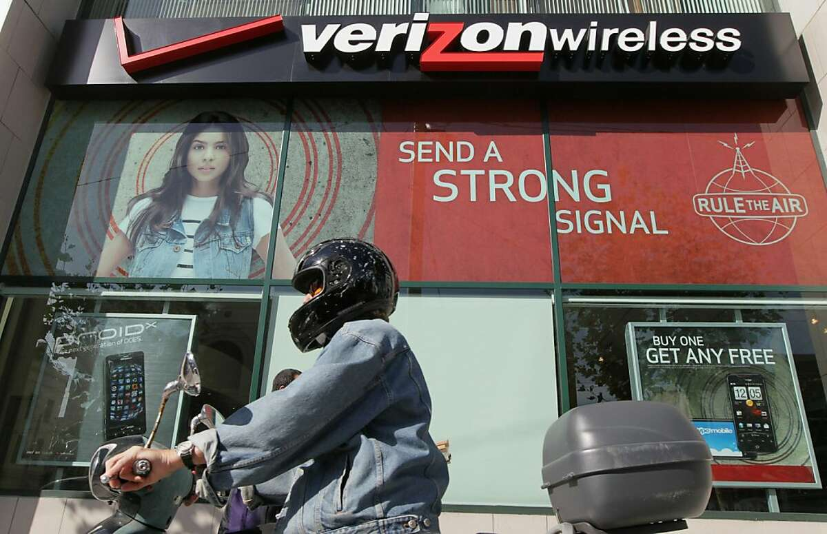 SAN FRANCISCO - OCTOBER 04: A scooter rider parks in front of a Verizon Wireless retail store on October 4, 2010 in San Francisco, California. Verizon Wireless is set to give refunds to 15 million of its subscribers who complained of