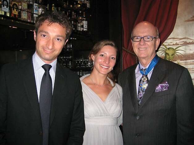 French Consul General Romain Serman (left) with his wife, Laura Serman, and Honorary Consul General to Monaco Tom Horn at Absinthe Restaurant. July 2011. By Catherine Bigelow. Photo: Catherine Bigelow, Special To The Chronicle