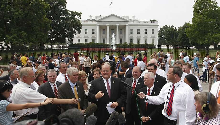 Rep. Tom Reed, R-N.Y., center, is joined by other members of congress outside the White House in Washington, Tuesday, July 19, 2011, after releasing a letter to President Barack Obama urging him to deal with the debt ceiling crisis. Photo: Pablo Martinez Monsivais, AP