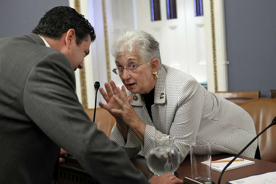 """Rep. Virginia Foxx, R-NC, right, a member of the House Rules Committee, speaks with House Budget Committee member Rep. Jason Chaffetz, R-Utah, left, before he testifies on the so-called """"cut, cap and balance"""" plan proposed by tea party-backed House Republicans, at the Capitol in Washington, Monday, July 18, 2011. Photo: J. Scott Applewhite, AP"""