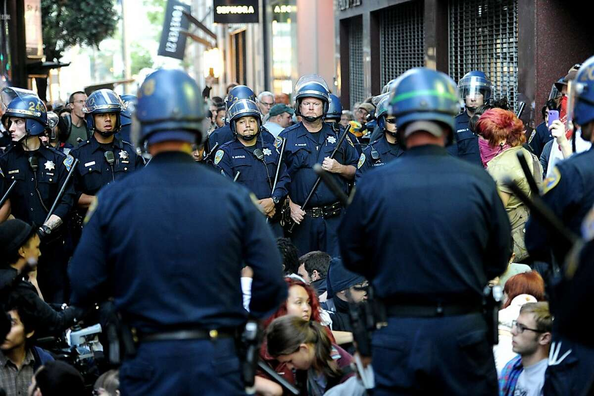 Police surround several dozen protesters, upset about the recent police shooting of Kenneth Wade Harding, before arresting them near Union Square on Tuesday, July 19, 2011, in San Francisco. Harding, a 19-year-old Washington state parolee, opened fire on officers before he was killed.