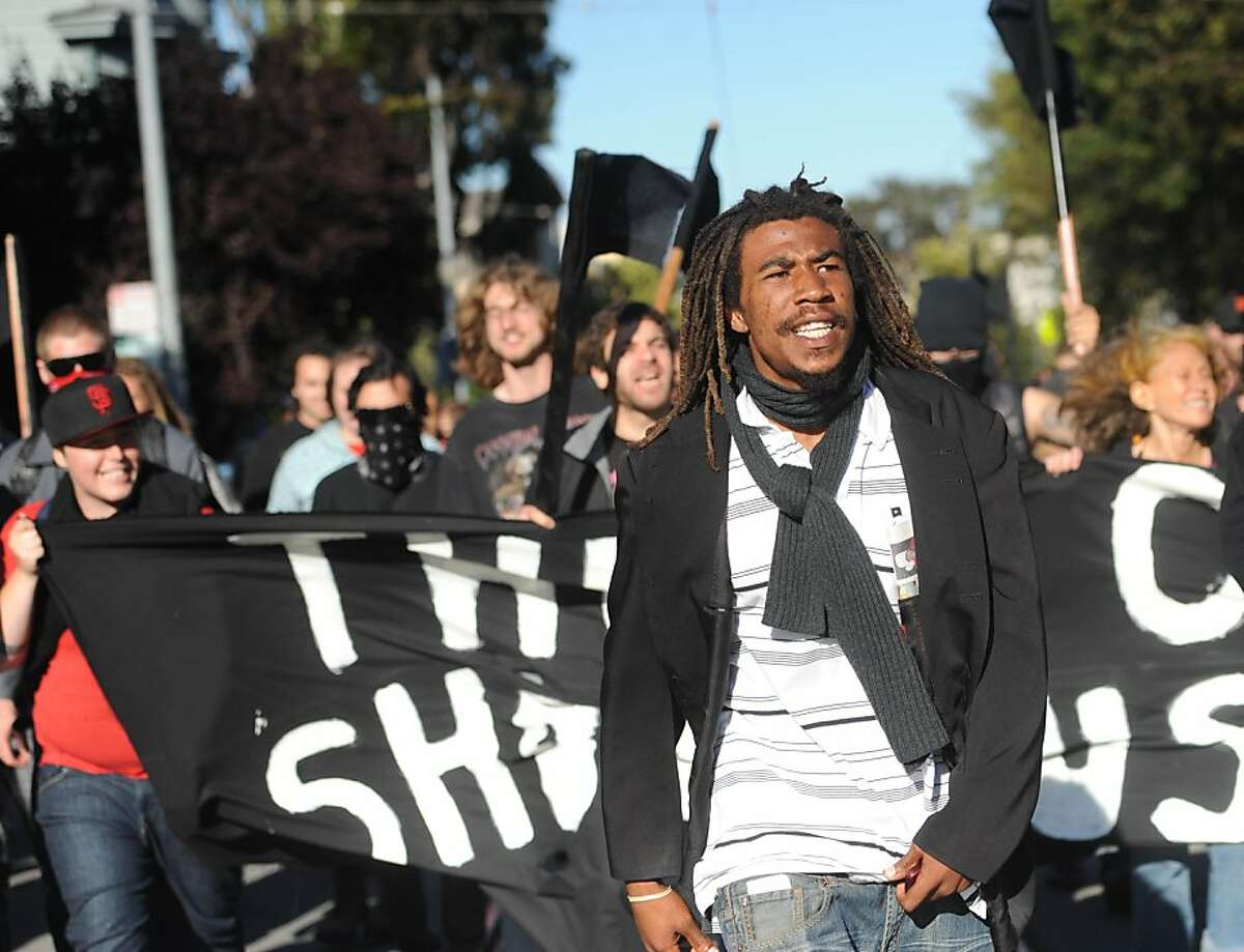 Protesters make their way down the street in San Francisco, Calif., on Tuesday, July 19, 2011. The group was protesting the recent police shooting of Kenneth Wade Harding, 19, a Washington state parolee, who opened fire on officers the previous Saturday.