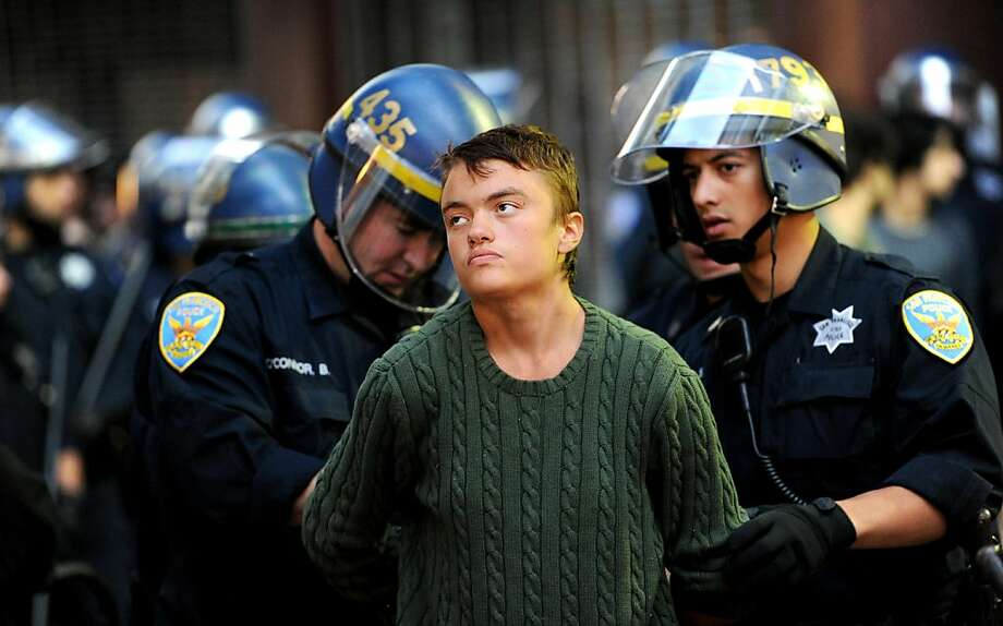 San Francisco Police Officers arrest an unidentified protester near the Powell Street BART station in July 2011 in San Francisco. Photo: Noah Berger, Special To The Chronicle