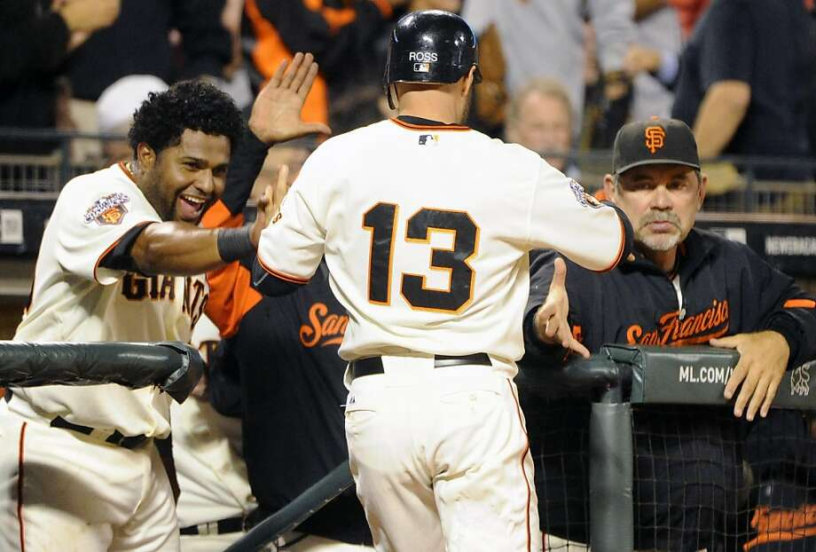 SAN FRANCISCO, CA - JULY 18: Cody Ross #13 of the San Francisco Giants celebrates with Pablo Sandoval #48 and manager Bruce Bochy #15 after he scored on an RBI single by Brandon Crawford against the Los Angeles Dodgers in the sixth inning during an MLB baseball game at AT&T Park July 18, 2011 in San Francisco, California. The Giants won the game 5-0. Photo: Thearon W. Henderson, Getty Images