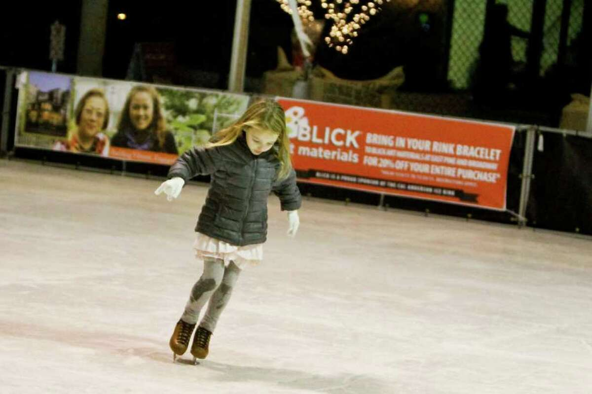 Alexa Horten, 5, skates at the Capitol Hill Ice Rink located at Cal Anderson Park in Seattle on Dec. 6, 2011. The ice rink does not actually contain any ice -- it utilizes polyurethane and a liquid to simulate the feel of ice skating. The ice rink was made possible by local business sponsors and the Seattle Parks Department, and the proceeds go to Cal Anderson park and the surrounding community.