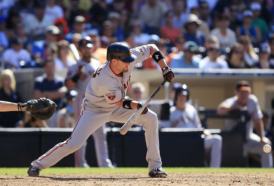 San Francisco Giants' Chris Stewart puts down the squeeze bunt that scored Emmanuel Burriss from third against the San Diego Padres in the 11th inning of the Giants' 4-3 victory in a baseball game Sunday, July 17, 2011 in San Diego. Photo: Lenny Ignelzi, AP