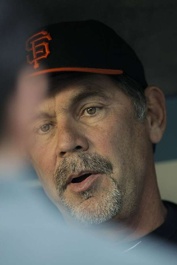 Giants manager Bruce Bochy talks in the dugout before the game against the Los Angeles Dodgers on Friday at Dodger Stadium. Photo: Michael Macor, The Chronicle
