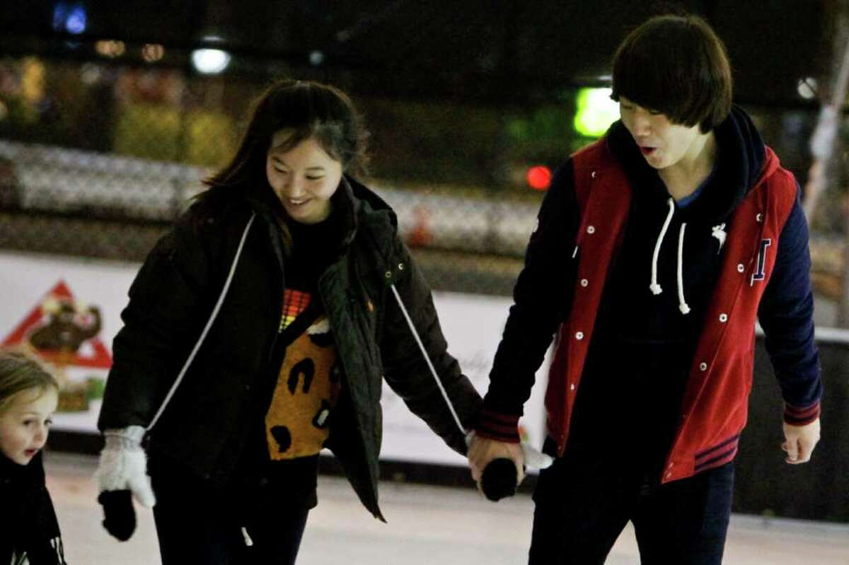 Doyeon Ki, and Kevin Baek skate at the Capitol Hill Ice Rink located at Cal Anderson Park in Seattle on Dec. 6, 2011.