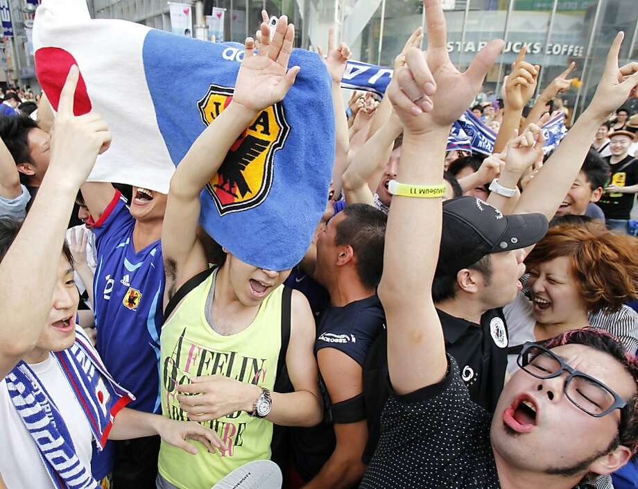 Japanese fans celebrate in Tokyo's Shibuya district Monday morning, July 18, 2011 after Japan beat the United States in their final match at the Women's Soccer World Cup Sunday, July 17 in Frankfurt, Germany. Photo: Koji Sasahara, AP