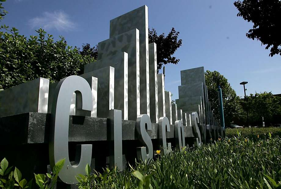 SAN JOSE, CA - FILE:  The Cisco Systems logo is seen in front of the company's headquarters August 8, 2005 in San Jose, California. It was reported that networking equipment makers CIsco Systems plans to layoff 6,500 employees in an effot to cut costs andraise profits July18, 2011. Photo: Justin Sullivan, Getty Images