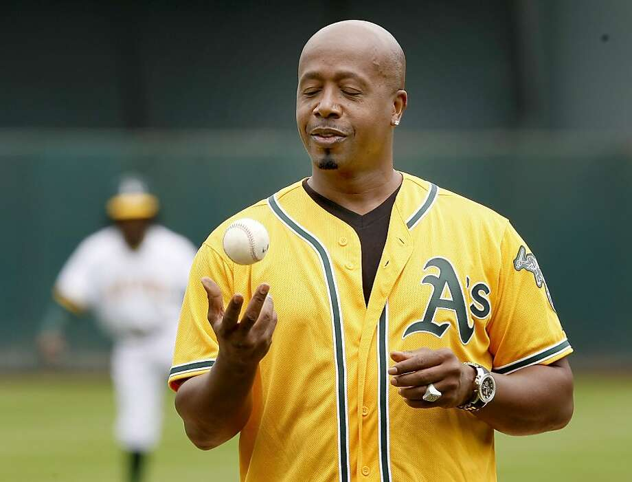 "MC Hammer prepares to throw out the second of two ""first pitches"" of the ballgame on MC Hammer bobblehead day at the Oakland Coliseum on Sunday. Photo: Brant Ward, The Chronicle"