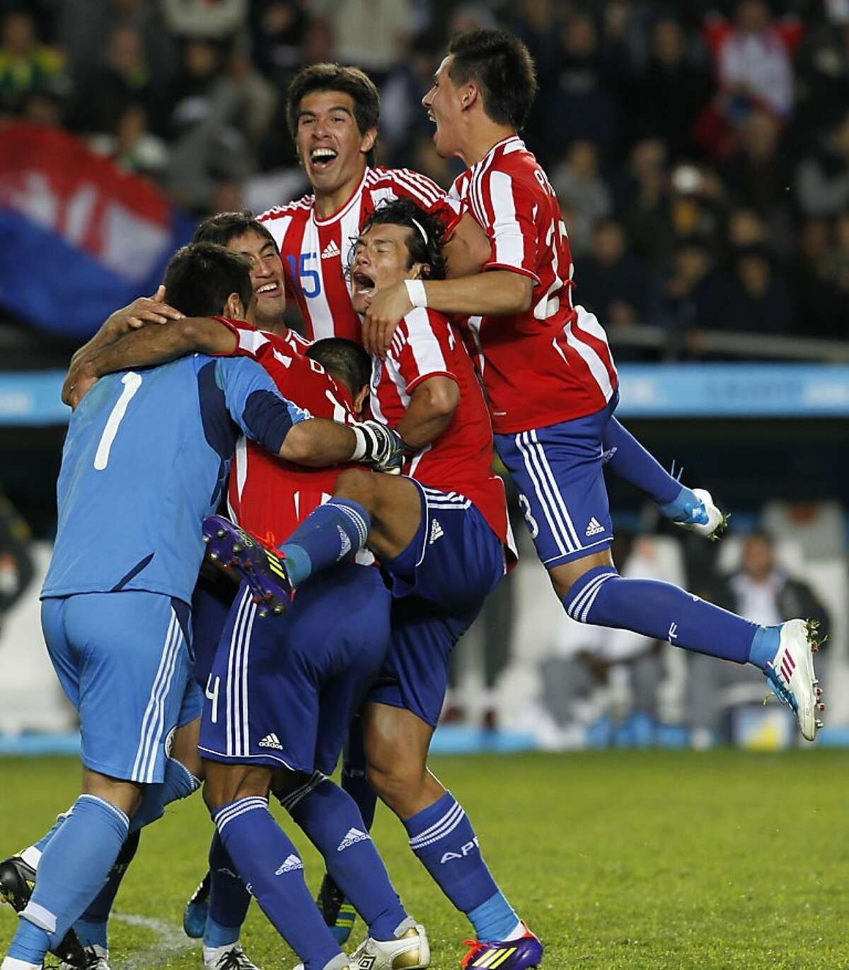 Paraguay's players celebrate after winning the penalty shootout against Brazil during a Copa America quarterfinal soccer match in La Plata, Argentina, Sunday, July 17, 2011.