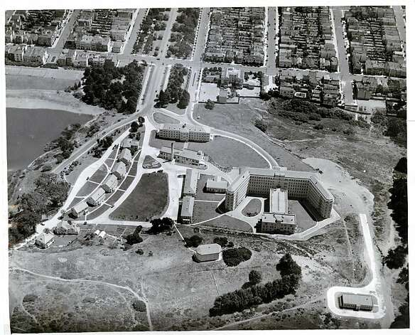 Undated pre-1950s aerial photo by Fred Mae shows the back of San Francisco's Public Health Service hospital in the Presidio and the edge of the Richmond District. The building was constructed in 1932 to replace an earlier version of the hospital, which originally opened in 1875 as the San Francisco Marine Hospital. In between the hospital and the building at the far lower right is the site of the old graveyard for merchant mariners. A new trail that opened in July 2011 commemorates those sailors with an overlook called Hospital Cemetery Vista. Photo: Fred Mae, Aero Photo