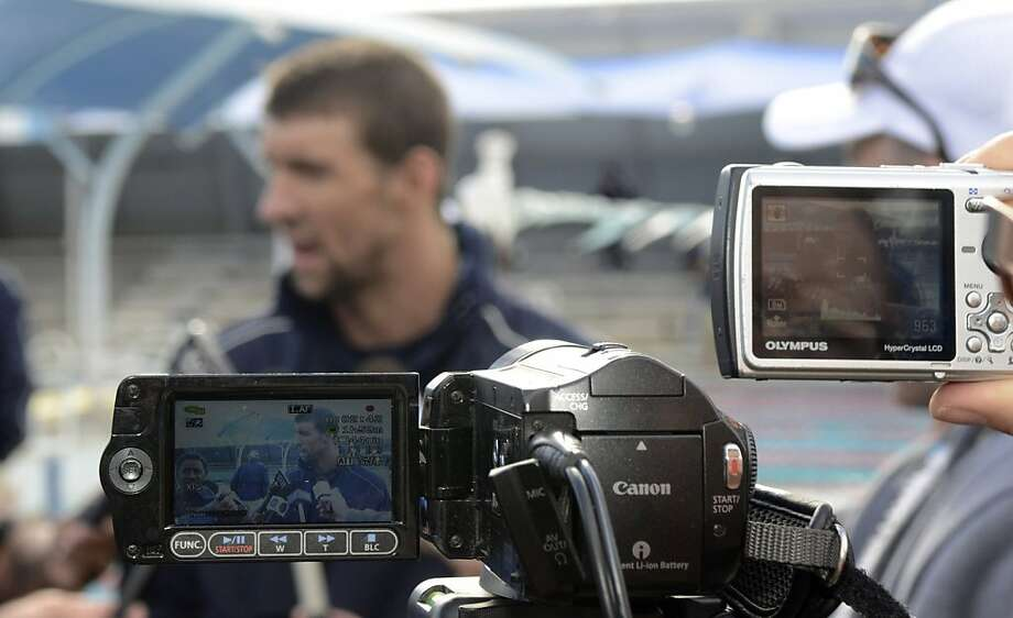 U.S. swimmer Michael Phelps talks to the media after his training at the Gold Coast Aquatic Center on the Gold Coast, Australia, Friday, July 15, 2011.  The U.S. swimming team members hold a training camp in Australia before the FINA World Championships in Shanghai, China. Photo: Steve Holland, AP
