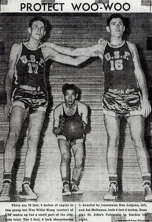 "Willie ""Woo Woo"" Wong of USF crouches between Dan Lofgran, left, and Joe McNamee, each 6'6"", in New York before an NIT game in 1950.  Willie Wong Photo: ??, ASSOCIATED PRESS"