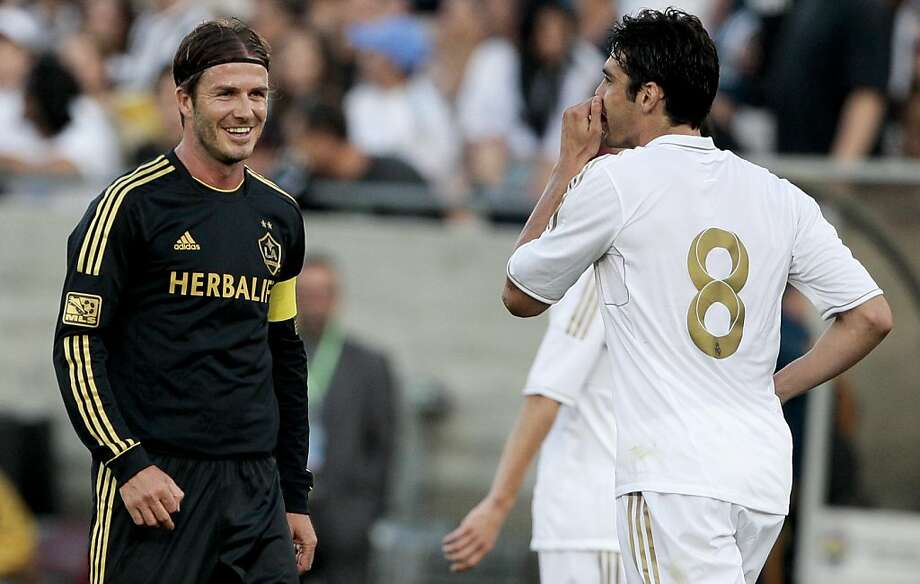 Los Angeles Galaxy midfielder David Beckham, left, jokes around with Real Madrid midfielder Kaka during the first half of an exhibition soccer match, Saturday, July 16, 2011, at Memorial Coliseum in Los Angeles. Photo: Bret Hartman, AP