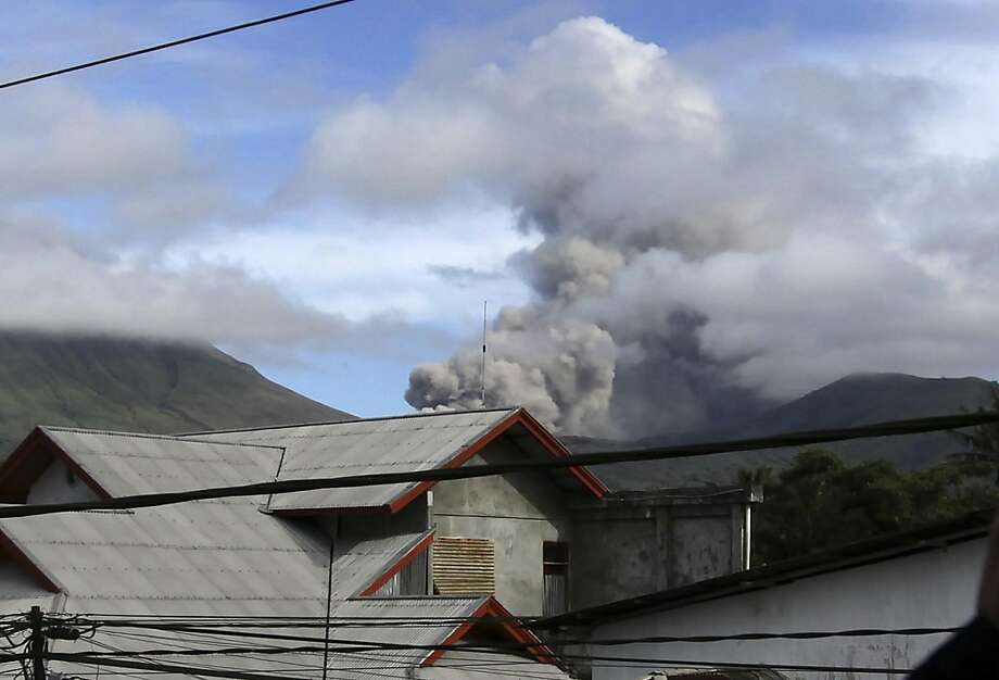 Mount Lokom spews volcanic ash in Tomohon, North Sulawesi, Indonesia, Saturday, July 16, 2011. The rumbling volcano has shot ash into the air in three relatively minor eruptions. No injuries were reported. Photo: AP