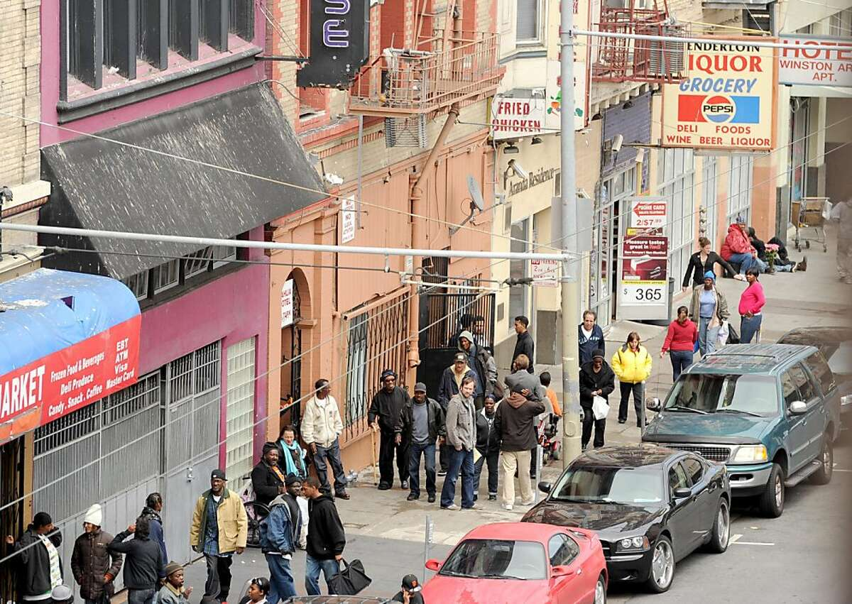 People congregate outside a liquor store on the 0-90 block of Turk St. on Wednesday, July 13, 2011, in San Francisco. Non-profit groups and small businesses are upset about the high rate of violent crime they say plagues the block.