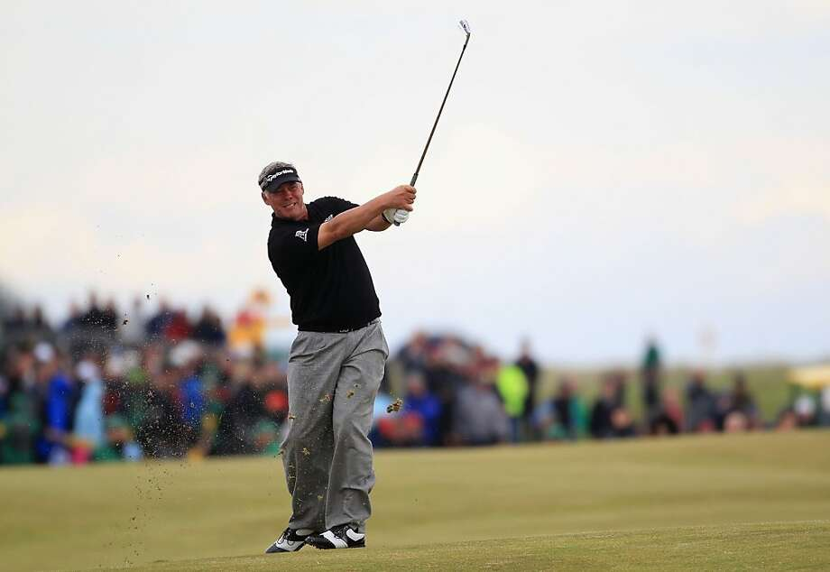 SANDWICH, ENGLAND - JULY 17:  Darren Clarke of Northern Ireland hits his approach shot on the 18th hole during the final round of The 140th Open Championship at Royal St George's on July 17, 2011 in Sandwich, England. Photo: Streeter Lecka, Getty Images