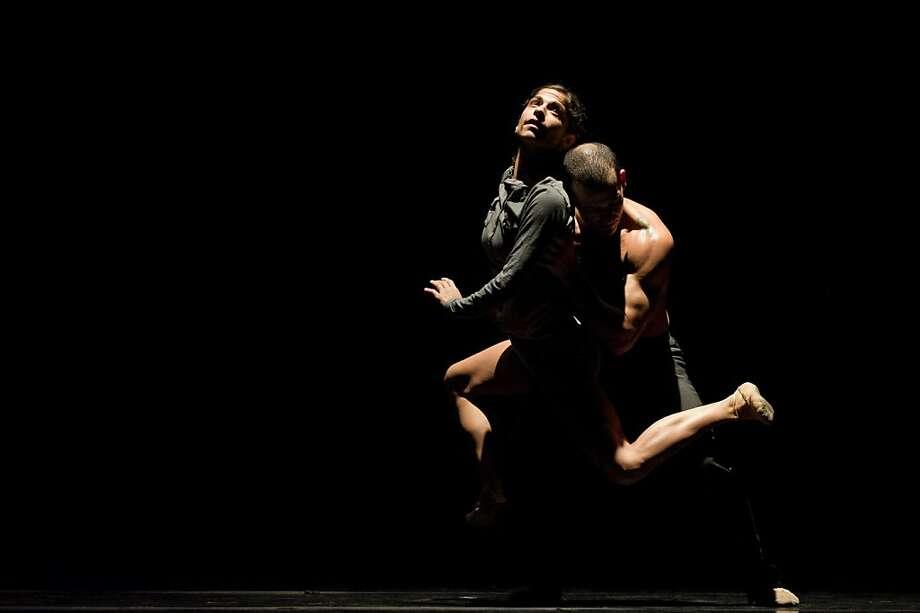 "Jenna McClintock and Brandon ""Private"" Freeman perform a new work by choreographer Amy Seiwert for the WestWave Dance Festival. Photo: David DeSilva"