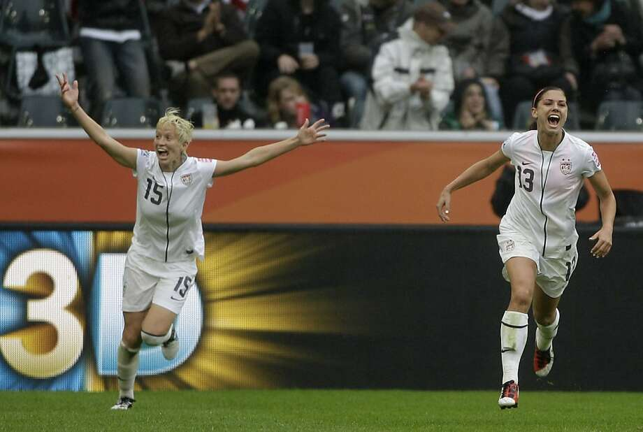 United States' Alex Morgan, right, celebrates scoring her side's 3rd goal during the semifinal match between France and the United States at the Women's Soccer World Cup in Moenchengladbach, Germany, Wednesday, July 13, 2011. Photo: Frank Augstein, AP