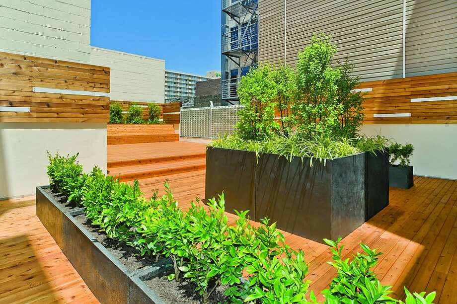 On the second level, a garden terrace provides lush landscaping and seating so residents can enjoy the San Francisco weather. Photo: Olga Soboleva, Vanguard Properties