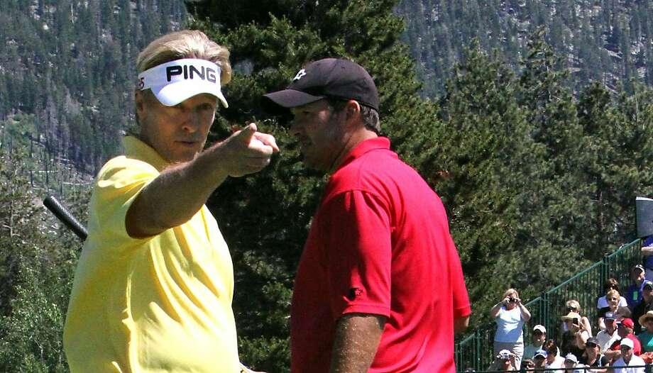 Actor Jack Wagner, left, stands with Dallas Cowboys quarterback Tony Romo, who he held off in the final round of the American Century Celebrity Golf Championship, Sunday, July 17, 2011 at the Edgewood Tahoe Golf Course in Stateline, Nev. Wagner is the only non-professional athlete to have won the tourney in its 22 years. Photo: Doug Etten, AP