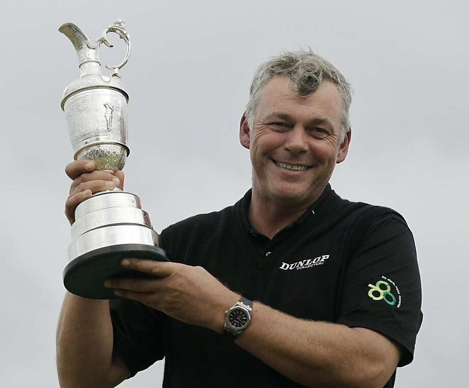 Northern Ireland's Darren Clarke holds the Claret Jug trophy as he celebrates winning the British Open Golf Championship at Royal St George's golf course Sandwich, England, Sunday, July 17, 2011. Photo: Matt Dunham, AP