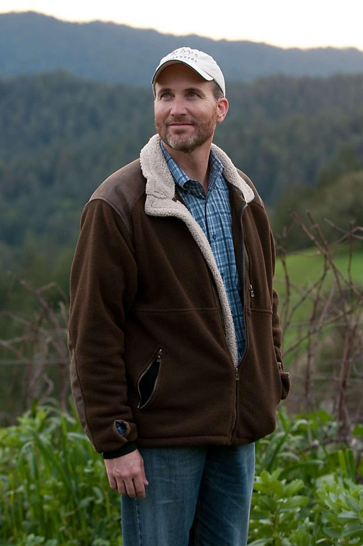 """Rhys Vineyards owner Kevin Harvey pauses in the """"Alpine Vineyard"""" of his winery."""