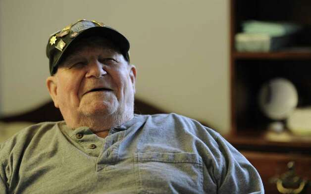 "Robert ""Gus"" Grimm speaks of his memories of the attack on Pearl Harbor almost 70 years ago at his home in Schenectady, N.Y. Dec. 5, 2011.   (Skip Dickstein/Times Union) Photo: Skip Dickstein / 2011"