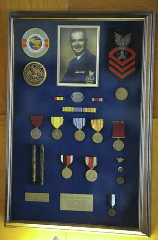 Pearl Harbor survivor William Langston's honors framed at his home in Latham, N.Y. Dec. 2, 2011.  (Skip Dickstein/Times Union) Photo: Skip Dickstein / 2011