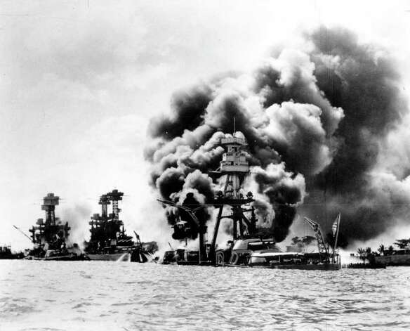 ** FILE ** Three U.S. battleships are hit from the air during the Japanese attack on Pearl Harbor on Dec. 7, 1941. Japan's bombing of U.S. military bases at Pearl Harbor brings the U.S. into World War II. From left are: USS West Virginia, severely damaged; USS Tennessee, damaged; and USS Arizona, sunk. Sixty-two years after that haunting Dec. 7 at Pearl Harbor, thoughts of the Japanese attack that killed 2,390 people are not far off for a nation that has seen more dismal days, fought in more wars, lostthousands more sons and daughters. (AP Photo) / U.S. NAVY