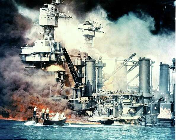 This December 7, 1941, photo from The National Archives shows the USS West Virginia burning after the surprise Japanese attack on Pearl Harbor, Hawaii. The carefully-planned and well-executed attack removed the United States Navy's battleship force as a possible threat to the Japanese Empire's southward expansion.  December 7, 2010 marks the 69th anniversary of the attack which abruptly brought America into the Second World War as a full combatant. AFP PHOTO/THE NATIONAL ARCHIVES (Photo credit should read HO/AFP/Getty Images) Photo: HO / AFP