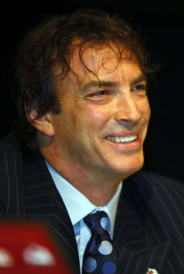 Former Colorado Avalanche captain Joe Sakic jokes with reporters after he announced his retirement from the Avalanche organization after 20 seasons on the ice during a news conference in the south Denver suburb of Englewood, Colo., Thursday, July 9, 2009. (AP Photo/David Zalubowski) Photo: David Zalubowski, AP