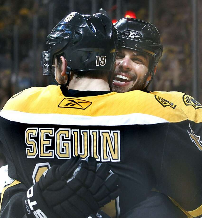 Boston Bruins center Tyler Seguin (19) is hugged by Boston Bruins right wing Nathan Horton after Seguin scored against the Tampa Bay Lightning in the second period of Game 2 of the NHL hockey Stanley Cup Eastern Conference final playoff series in Boston Tuesday, May 17,  2011. Photo: Elise Amendola, AP