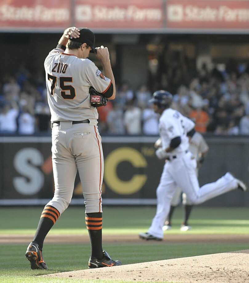 Barry Zito #75 of the San Francisco Giants steps off the mound as Jesus Guzman #15 of the San Diego Padres rounds the bases after hitting a three-run homer during the first inning of a baseball game at Petco Park on July 16, 2011in San Diego, California. Photo: Denis Poroy, Getty Images