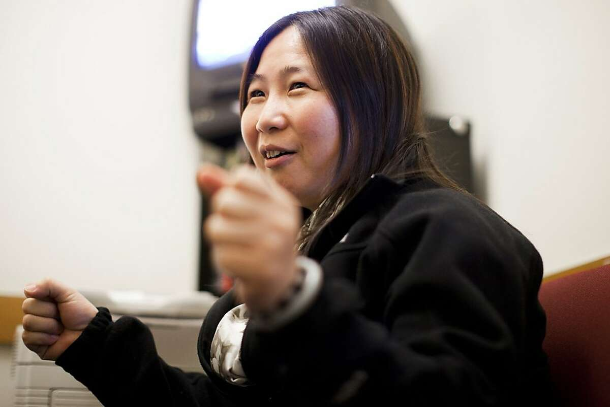 Former restaurant worker Li Shuang Li speaks during an interview with the Chronicle at City Hall in San Francisco, Calif. on Thursday, July 14, 2011. Li, a new immigrant from China and a mother of two, had worked at a restaurant in Chinatown for seven years for about $900 a month without health benefits before realizing her employer was withholding her tips through various excuses. Li is now a frequent volunteer at the Chinese Progressive Association helping other in similar situations.